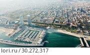 Купить «Aerial view of seaside area of Barcelona with harbor on sunny day, Catalonia, Spain», видеоролик № 30272317, снято 16 ноября 2018 г. (c) Яков Филимонов / Фотобанк Лори