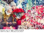 Купить «Girl with woman choosing Christmas gifts for family», фото № 30273537, снято 19 декабря 2017 г. (c) Яков Филимонов / Фотобанк Лори