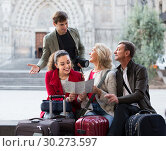 Купить «Tourists with map and baggage in city», фото № 30273597, снято 24 марта 2019 г. (c) Яков Филимонов / Фотобанк Лори