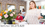 Купить «Portrait of young woman administrator inviting to beauty salon», фото № 30273829, снято 25 апреля 2018 г. (c) Яков Филимонов / Фотобанк Лори
