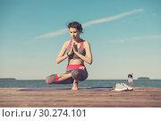 Купить «Sporty young girl in the morning on the pier on seashore, practicing yoga. Woman do gymnastics outdoors. Health and Yoga Concept. Female meditation for fitness lifestyle the nature background», фото № 30274101, снято 23 июня 2018 г. (c) Сергей Тимофеев / Фотобанк Лори