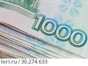 Купить «Деньги. Несколько банкнот номиналом в 1000 рублей (крупный план)», фото № 30274633, снято 2 марта 2019 г. (c) Екатерина Овсянникова / Фотобанк Лори