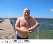 Portrait of a middle aged man standing at the pier on the background of the sea. Стоковое фото, фотограф Дмитрий Морозов / Фотобанк Лори