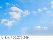 Купить «Sky background. Blue sky landscape with pastel sunset clouds lit by evening sunset light», фото № 30275249, снято 28 марта 2018 г. (c) Зезелина Марина / Фотобанк Лори