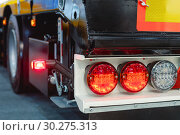 Купить «Car trailer brake lights. Modern lighting equipment for road transport», фото № 30275313, снято 6 июня 2018 г. (c) Андрей Радченко / Фотобанк Лори