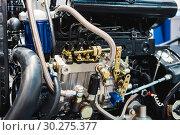 Купить «Internal combustion engine automotive», фото № 30275377, снято 6 июня 2018 г. (c) Андрей Радченко / Фотобанк Лори