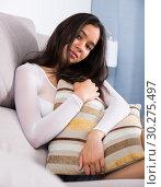 Купить «Gloomy teenager girl with pillow», фото № 30275497, снято 30 мая 2017 г. (c) Яков Филимонов / Фотобанк Лори