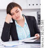 Купить «Female employee is reading documents about the transaction», фото № 30275581, снято 21 мая 2017 г. (c) Яков Филимонов / Фотобанк Лори