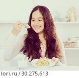 Купить «smiling girl eating tasty mixture of cereals», фото № 30275613, снято 30 мая 2017 г. (c) Яков Филимонов / Фотобанк Лори