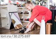 Купить «Woman is trying on sandals», фото № 30275697, снято 27 мая 2017 г. (c) Яков Филимонов / Фотобанк Лори
