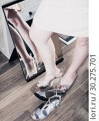 Купить «woman posing in new sandals in heels», фото № 30275701, снято 27 мая 2017 г. (c) Яков Филимонов / Фотобанк Лори