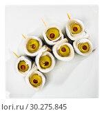 Купить «Top view of herring rolls with olives», фото № 30275845, снято 27 марта 2019 г. (c) Яков Филимонов / Фотобанк Лори