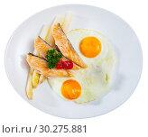 Купить «Top view of fried eggs with salmon and asparagus», фото № 30275881, снято 20 июля 2019 г. (c) Яков Филимонов / Фотобанк Лори