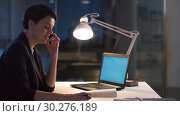 Купить «businesswoman calling on smartphone at dark office», видеоролик № 30276189, снято 1 марта 2019 г. (c) Syda Productions / Фотобанк Лори