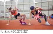 Купить «Two young athletic women doing sport exercises on their legs. Warming up», видеоролик № 30276221, снято 23 марта 2019 г. (c) Константин Шишкин / Фотобанк Лори