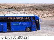 Купить «Туристический автобус компании Pegas Touristik стоит с открытыми дверями на дороге через пустыню Сахара. Тунис, Африка», фото № 30293821, снято 2 мая 2012 г. (c) Кекяляйнен Андрей / Фотобанк Лори