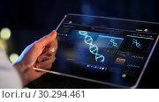 Купить «hand with virtual dna projection on tablet screen», видеоролик № 30294461, снято 22 мая 2019 г. (c) Syda Productions / Фотобанк Лори