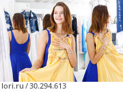 Купить «Woman trying dress in fitting room», фото № 30294613, снято 17 сентября 2018 г. (c) Яков Филимонов / Фотобанк Лори