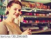 Купить «female customer looking for lipstick in cosmetics shop», фото № 30294665, снято 21 февраля 2017 г. (c) Яков Филимонов / Фотобанк Лори