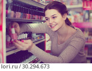 Купить «female customer looking for nail polish in cosmetics shop», фото № 30294673, снято 21 февраля 2017 г. (c) Яков Филимонов / Фотобанк Лори