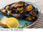 Купить «Image of mussels with sauce», фото № 30294929, снято 25 июня 2018 г. (c) Яков Филимонов / Фотобанк Лори