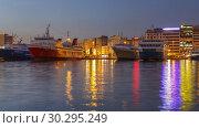 Купить «Timelapse of day to night transition in port Piraeus, Greece», видеоролик № 30295249, снято 11 марта 2019 г. (c) Sergey Borisov / Фотобанк Лори