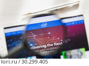 California, USA - 7 March 2019: Intel Corporation official website homepage under magnifying glass. Concept Intel Corporation, CPU logo visible on smartphone, tablet screen, Редакционное фото, фотограф Сергей Тимофеев / Фотобанк Лори