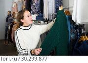 Купить «Woman shopping in outerwear clothing boutique», фото № 30299877, снято 6 декабря 2018 г. (c) Яков Филимонов / Фотобанк Лори
