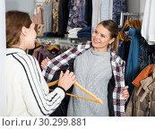 Купить «Woman trying new overcoat», фото № 30299881, снято 6 декабря 2018 г. (c) Яков Филимонов / Фотобанк Лори