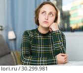 Купить «Portrait of sorrowful woman sitting at home», фото № 30299981, снято 6 ноября 2018 г. (c) Яков Филимонов / Фотобанк Лори