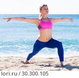 Купить «Woman 28-35 years old is practicing yoga», фото № 30300105, снято 6 мая 2017 г. (c) Яков Филимонов / Фотобанк Лори