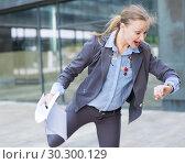 Купить «Portrait of busy female rushing to important meeting», фото № 30300129, снято 6 мая 2017 г. (c) Яков Филимонов / Фотобанк Лори