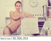 Купить «smiling girl in underpants in the office», фото № 30306353, снято 24 апреля 2017 г. (c) Яков Филимонов / Фотобанк Лори