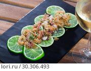 Купить «Fried calamari and sepia in a batter of tempera flour and glass of wine», фото № 30306493, снято 24 марта 2019 г. (c) Яков Филимонов / Фотобанк Лори