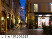 Купить «View on lanes with Christmas illumination in night Parma of Italy», фото № 30306525, снято 5 декабря 2017 г. (c) Яков Филимонов / Фотобанк Лори
