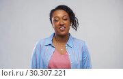 Купить «happy african american woman having interview», видеоролик № 30307221, снято 10 марта 2019 г. (c) Syda Productions / Фотобанк Лори