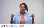Купить «happy african american woman celebrating success», видеоролик № 30307229, снято 10 марта 2019 г. (c) Syda Productions / Фотобанк Лори