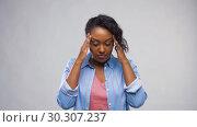 Купить «african american woman suffering from headache», видеоролик № 30307237, снято 10 марта 2019 г. (c) Syda Productions / Фотобанк Лори