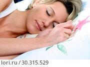 Купить «Blond sleeping woman, lying in bed.», фото № 30315529, снято 27 марта 2019 г. (c) age Fotostock / Фотобанк Лори