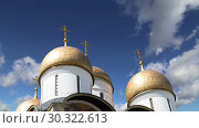 Купить «Assumption Cathedral (Cathedral of the Dormition, Uspensky sobor) against the sky. Inside of Moscow Kremlin, Russia (day)», видеоролик № 30322613, снято 15 марта 2019 г. (c) Владимир Журавлев / Фотобанк Лори