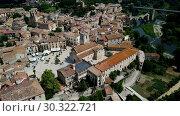 Купить «Aerial view of historic centre of Besalu with Romanesque bridge over Fluvia river, Catalonia, Spain», видеоролик № 30322721, снято 23 июня 2018 г. (c) Яков Филимонов / Фотобанк Лори