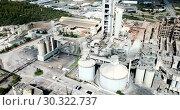 Купить «Aerial view of cement production plant», видеоролик № 30322737, снято 29 августа 2018 г. (c) Яков Филимонов / Фотобанк Лори