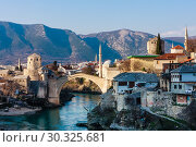 Beautiful view on Mostar city with old bridge and ancient buildings on Neretva river in Bosnia and Herzegovina (2018 год). Стоковое фото, фотограф Николай Коржов / Фотобанк Лори