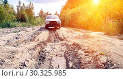 Купить «City car moves on a broken dirt road on a sunny day.», фото № 30325985, снято 24 июля 2011 г. (c) Акиньшин Владимир / Фотобанк Лори