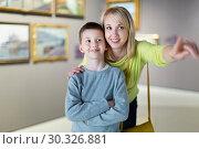 Купить «Mother and son regarding paintings in halls of museum», фото № 30326881, снято 18 марта 2017 г. (c) Яков Филимонов / Фотобанк Лори