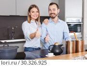 Купить «Loving couple in kitchen», фото № 30326925, снято 24 мая 2018 г. (c) Яков Филимонов / Фотобанк Лори