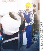 Купить «Worker work with cement mixer», фото № 30327077, снято 17 января 2017 г. (c) Яков Филимонов / Фотобанк Лори