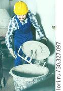 Купить «Man using concrete mixer for construction at workplace», фото № 30327097, снято 17 января 2017 г. (c) Яков Филимонов / Фотобанк Лори