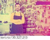 Купить «Adult male seller demonstrating assortment», фото № 30327213, снято 2 марта 2017 г. (c) Яков Филимонов / Фотобанк Лори