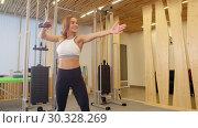 Купить «Athlete smiling woman doing fitness in the gym», видеоролик № 30328269, снято 25 марта 2019 г. (c) Константин Шишкин / Фотобанк Лори